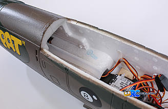 Battery location has tracks that holds the battery tray
