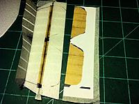 Name: Stab 2_797x595.jpg Views: 123 Size: 87.8 KB Description: Hinge on bottom of stab covered with a thin strip of printed tissue. Top of stab is already tissue cobvered.