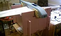 """Name: IMAG0124.jpg Views: 257 Size: 37.7 KB Description: Cutting access hatches on the new work stand, which was built out of left-over 1"""" pink foam."""