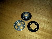 Name: 2011-11-21_17-51-36_770.jpg Views: 107 Size: 216.1 KB Description: The motor mounts and the reinforcement plates. The supplied motor mounts are flimsy.
