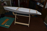 Name: DSC_0059.jpg Views: 164 Size: 104.2 KB Description: The hull is straightened and the transom is attached.  I also made a stand.