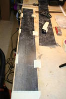 Name: IMG_8044.jpg Views: 424 Size: 69.5 KB Description: A little setup to cut the .007 reinforcement stripes. If you believe the fibers are straight you can just rip them instead of cutting.