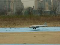 Name: cargo landing.jpg Views: 274 Size: 61.8 KB Description: Multiplex Cargo plane landing at NeungGok.  4 brushless ESCs and motors!