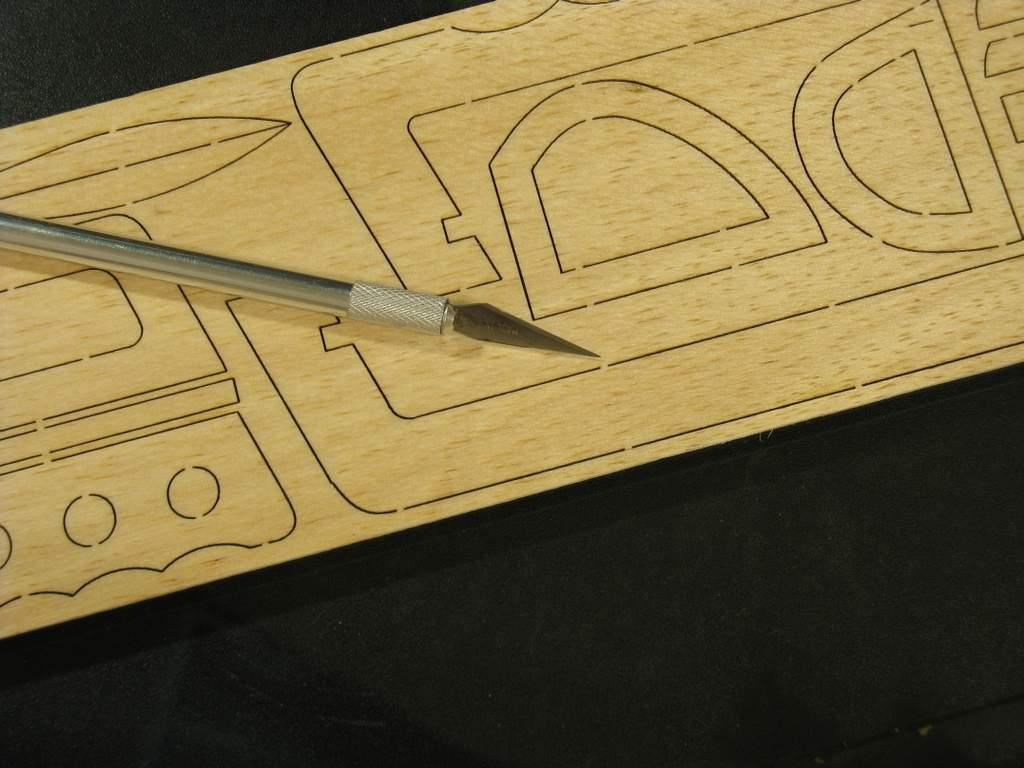 Name: mSSLCBuild02.jpg Views: 261 Size: 75.5 KB Description: Carefully cut tabs holding parts in balsa sheet