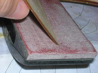 Name: DSCN1709.jpg Views: 395 Size: 120.1 KB Description: So I bevel with sandpaper at an angle so that it will sit square on the leading edge light plywood.