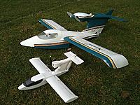 Name: Seawinds.jpg Views: 80 Size: 270.9 KB Description: Lots or scrapes, scratches and scuffs but still flying nice. The little one is a 60gm UM version using an AR6400 brick and remote aileron servo.