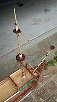 Name: IMG_0237.jpg Views: 101 Size: 102.2 KB Description: Foremast with crows nest and bowsprit. Forecastle has deck and railing. YAY! The green clinker panels on side are made of balsa.