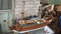 Name: IMG_0245.jpg Views: 97 Size: 240.9 KB Description: The forecastle is mostly done and the side planking has been installed.  I used 1mm balsa sheet cut to profile and then would cut fine 3mm strips of balsa and glue over the top in a clinker arrangment. Immediately behind the foremast is an access hatch