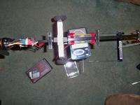 Name: 100_0160.jpg Views: 113 Size: 80.7 KB Description: The plane minus the receiver, camera, and wing weighs 21.195 ounces. So the total weight will be around 33 ounces.
