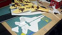 """Name: 2010-09-17_10-34-21_256 (1280x722).jpg Views: 139 Size: 61.2 KB Description: Baby Tomhe Raptor (16"""") on the build with repaired and decaled SU-35."""