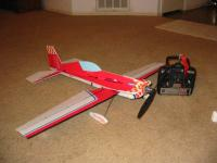 Name: Picture 011.jpg Views: 455 Size: 89.2 KB Description: My First 3d plane. The Great Planes Flatouts Extra 300s. Loved how it flew but way too fragile. Broke on maiden when I attempted to land. :(