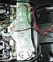 Name: 4 Srews.jpg Views: 312 Size: 134.1 KB Description: I would suggest moving the Tx's board out of the way before drilling out the trainer/sim port. Remove the 5 screws and lift from the left side to release the board away from the port.