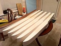 Name: Floats-3.jpg Views: 130 Size: 225.6 KB Description: Here are the six floats (three sets) cut out. I used my band saw to do most of the cutting. However, while I still had a flat bottom, I cut a groove up in at the back of the step using my table saw. This will be used to glue in a piece of plywood to stiff