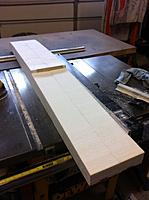 Name: Floats-6.jpg Views: 122 Size: 91.6 KB Description: Here I'm set up to sand out the rough spots from the band saw. I slipped a scrap piece of ply into the step slot to lock the two floats into position. I also used my cross cut sled on the table saw to trim the front and rear ends.