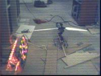 Name: fpv37.jpg Views: 293 Size: 86.9 KB Description: First result with the camera running on the voltage converter.  Definitely white bars on 1.