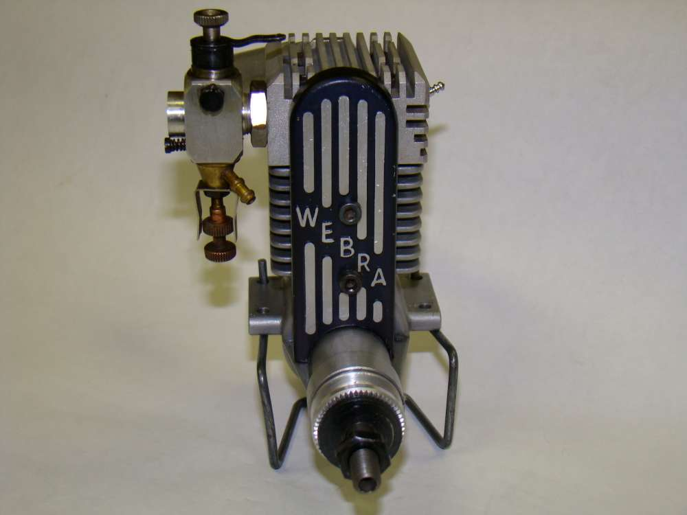 Name: Webra T4- .40 1-1000.jpg Views: 902 Size: 37.2 KB Description: This is the Webra T4-.40. It's another rotary valve 4-cycle. Unlike the HP .21 below this one uses a belt to drive the valves.