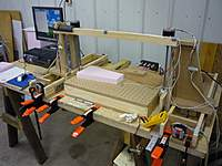 Name: P1000429s.jpg Views: 305 Size: 72.6 KB Description: A little less clutter with a block of foam ready to be cut.