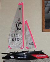 Name: 3-7-2015 Sail Set - main and jib 008 crop.jpg Views: 71 Size: 48.1 KB Description: Checking for size on the F2-60 cat.   Sails taped to wall, hulls set in front.