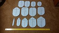 Name: paper templates for 2 meter.jpg Views: 16 Size: 1.02 MB Description: Photo of the 12 templates needed for the basic hull shape - to be glued to foam board or 1/4 inch birch ply and then cut and sanded to be spaced along the building board.  Template numbering starts at the stern with #0 and goes forward to #12