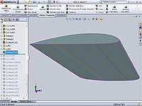 Name: Wing Spar Trim.jpg Views: 275 Size: 70.7 KB Description: Used the wing surface I made earlier, and did a Surface-Cut on the spars to trim the bottom to match the ribs.