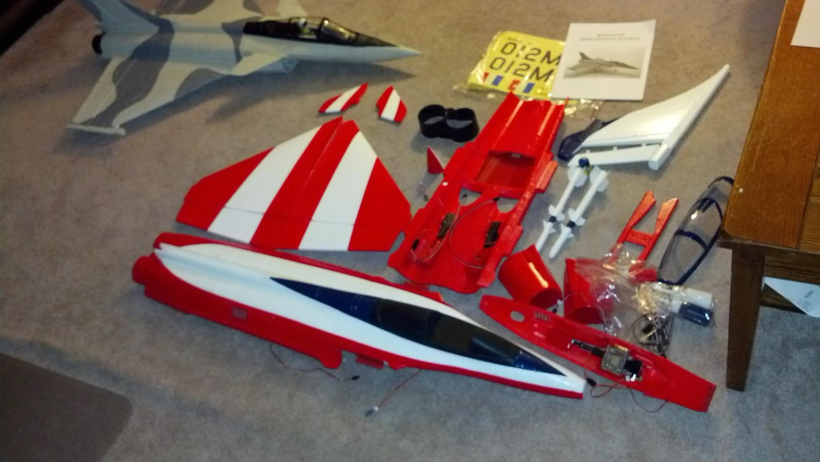Name: 2012-08-29_19-34-28_444.jpg Views: 142 Size: 135.7 KB Description: The Rafale kit parts.