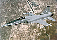 """Name: F-20_flying.jpg Views: 331 Size: 135.8 KB Description: Here you can see that bend in the turtledeck behind the canopy, that """"valley"""" at the base of the canopy glass slowly blends in and fades away as you go back.  Get it wrong and it looks terrible to me."""