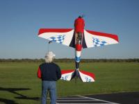 Name: Eddie Hill's Yak hover at Wichita Falls Texas March 2007 011.jpg Views: 230 Size: 54.3 KB Description: Eddie Hill huckin' his Composite-ARF Yak/ BME 110 in Wichita Falls, Texas