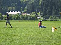 Name: Ken and Jeremy Fursman relaxing on field.jpg