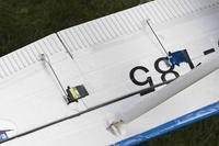 """Name: underwing.jpg Views: 621 Size: 70.5 KB Description: 4mm x 25"""" carbon spars added to wing.  Ailerons and flaps hinged with Monokote trim sheet.  HS 55s actuate the flaps."""