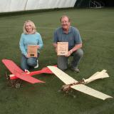 Scott Christensen and his wife Marcia with Scott's Fun Scale winning Deperdussin (in Red) and Sport Scale winning Antoinette. (Joe Malinchak photo).
