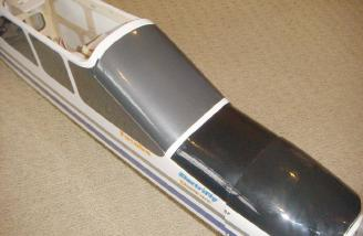 The battery is accessed from a forward hatch, so no need to remove the wing between flights. Magnets hold the hatch securely in place during flight.