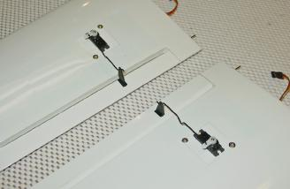 The aileron servo hatches fit tightly into the wing. I only used two of the supplied screws to mount them.