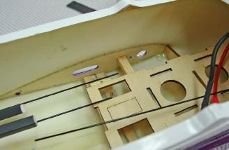 I epoxied in the radio tray that supports the battery and the elevator and rudder servo.