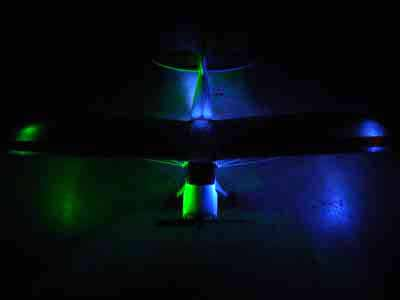 Name: DSC04243.jpg Views: 609 Size: 37.9 KB Description: I tape a set under each wing and aim the light at the fuselage.