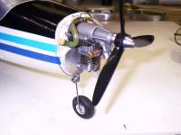 Name: co pilot's side of the Norvel AME .061.jpg Views: 619 Size: 41.4 KB Description: The Norvel does a reliable job of drawing fuel from a pressurized Sullivan 2oz tank located at the aircrafts CG.