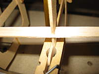 """Name: staggerwing build 008.jpg Views: 161 Size: 41.4 KB Description: Something lost in translation:  The natural fit of the side keel extends 1/16"""" past the former.  A straight edge confirms this former is not wide enough.  A strip of 1/16"""" sq. will be added to both sides to match the keel."""