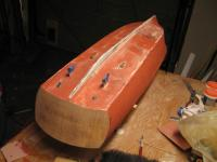 Name: Chris Craft Hull 001.jpg Views: 285 Size: 59.1 KB Description: Hull fiberglassed with a coat of spot putty. I did not spot putty the transom since I plan to apply mahogany to it.