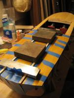 Name: Chris Craft Hull 017.jpg Views: 329 Size: 75.6 KB Description: Method for holding decking down while epoxy dries- anything that works! I am using steel blocks and tape.