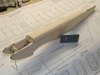 Name: Photo_11.jpg Views: 455 Size: 84.5 KB Description: The turtle deck is rough shaped with a razor plane using the plywood fuselage former as a shaping guide