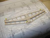 Name: Photo_19.jpg Views: 436 Size: 99.2 KB Description: The spar and filler block pieces are glued to each side of the stab core and then sanded to triangular airfoil.