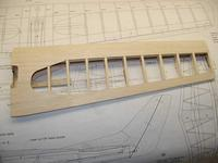 """Name: Photo_39.jpg Views: 379 Size: 81.1 KB Description: Next the cap strips are added to each rib. The cap strips are made from 1/4"""" x 1/16"""" balsa strip stock."""