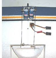 Name: SEAWIND-BOTH-SERVOS-INSTALL.jpg Views: 151 Size: 19.0 KB Description: Push rods not aligned, this is just an installation photo. Red tape for the Right Aileron