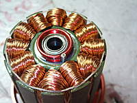 Name: Q-2.6 192.jpg Views: 497 Size: 97.1 KB Description: Note...string to retain copper....rollpin and C- clip to getain stator...not much glue.....good