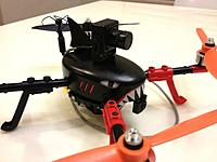 Name: EOX FPV Shark.jpg Views: 78 Size: 38.0 KB Description: Though cool looking, this Fatshark vtx and cam are way too heavy to be practical.  I was just playing around til I got a frame with better mounting options.