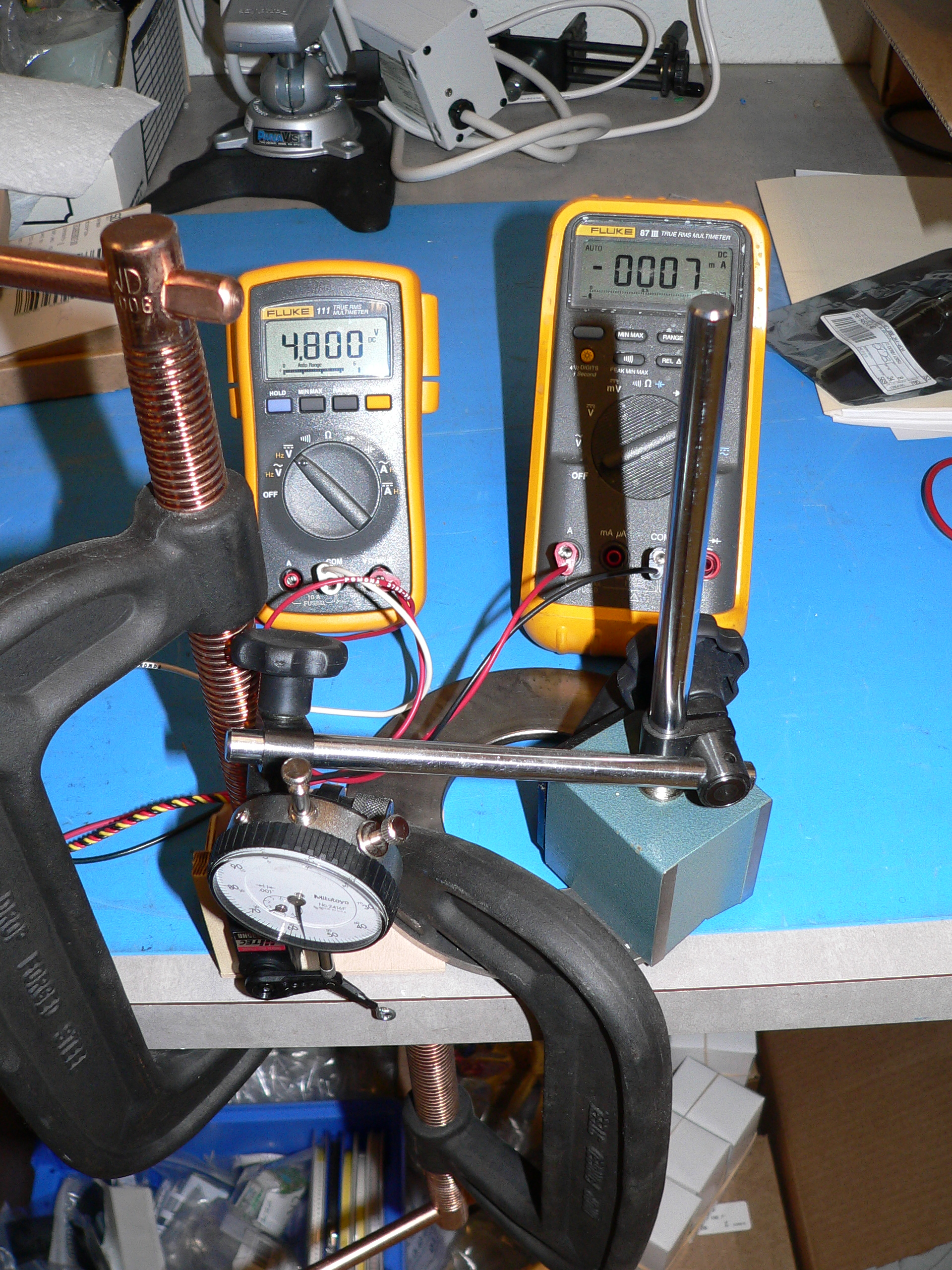 Name: test_setup_1.jpg Views: 506 Size: 2.33 MB Description: This mess actually does something.  The multimeters are used to measure the current and voltage supplied to the servo.  The dial indicator allows me to measure the position of the servo horn.