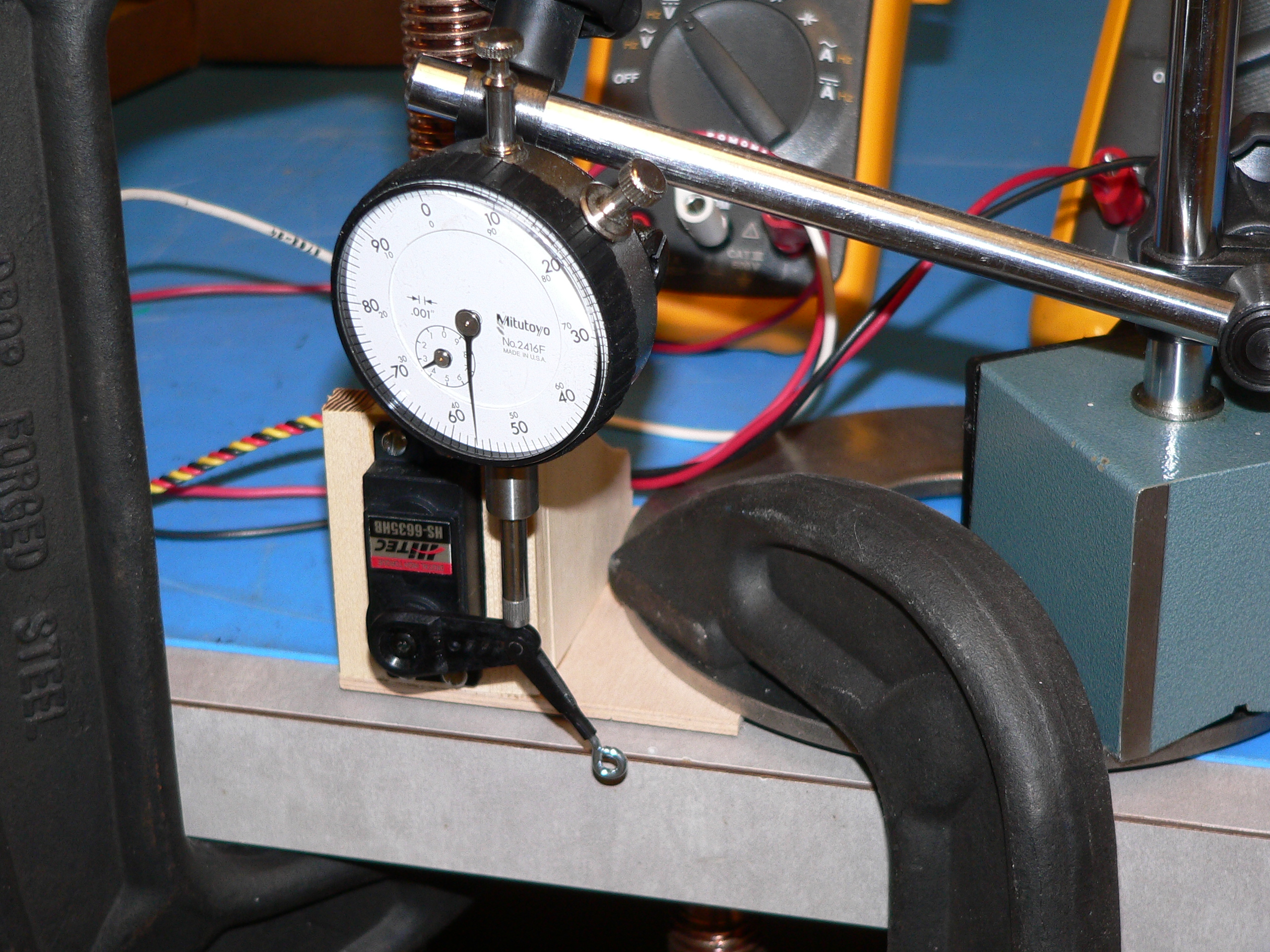 Name: test_setup_2.jpg Views: 504 Size: 2.13 MB Description: Here you can see the frame made to hold the servo in place.  The dial indicator is pushed by the servo arm.