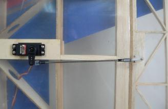 The HS-6635HB installed on the aileron of our Ultra Stik Lite.  Note the strong 4-40 linkage.