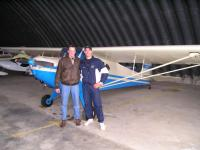 Name: P1010099.jpg Views: 364 Size: 79.1 KB Description: My best friend Jim and I after a flight in the Taylorcraft