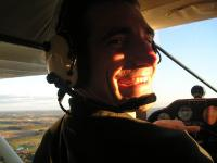 Name: P1010108.jpg Views: 289 Size: 51.8 KB Description: a pic my wife took of me while I was flying her around in the Tri-pacer. (her first ever small plane ride)