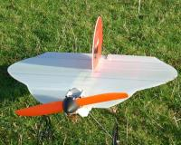 Name: 100_0448m.jpg Views: 806 Size: 82.1 KB Description: Coroplast traced around original wing. Note CF rods to prevent flap...